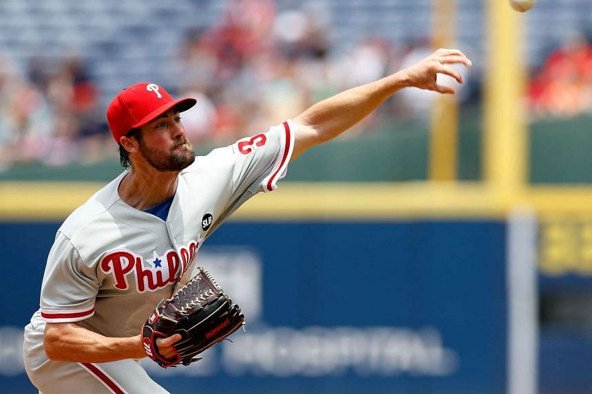 Cole Hamels throws a pitch in the fourth nning during the game against the Atlanta Braves at Turner Field.