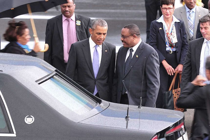 Ethiopian Prime Minister Hailemariam Desalegn (right) speaks with US President Barack Obama (left) upon his arrival at Bole International Airport in Addis Ababa.