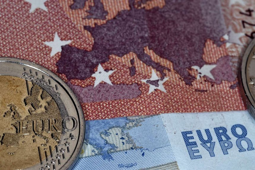 A file picture of the map of Europe represented on a euro coin and banknotes. PHOTO: AFP