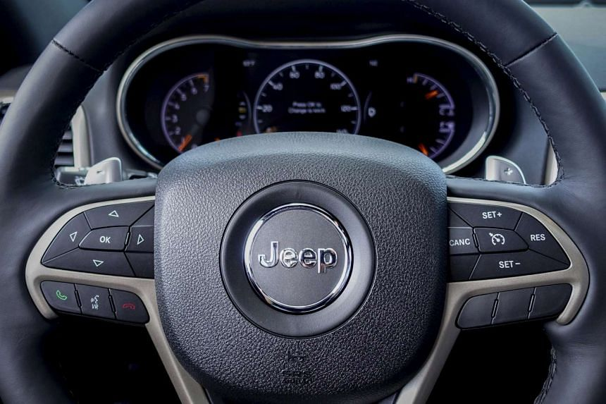 A file picture of a Fiat Jeep Grand Cherokee is pictured. Fiat Chrysler will recall 1.4 million vehicles in the United States to install software to prevent hackers from gaining remote control of the engine, steering and other systems in what federal