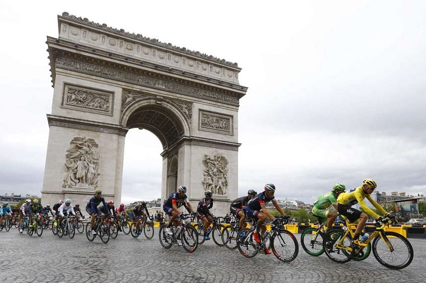 Froome leads the pack near the Arc de Triomphe in Paris.