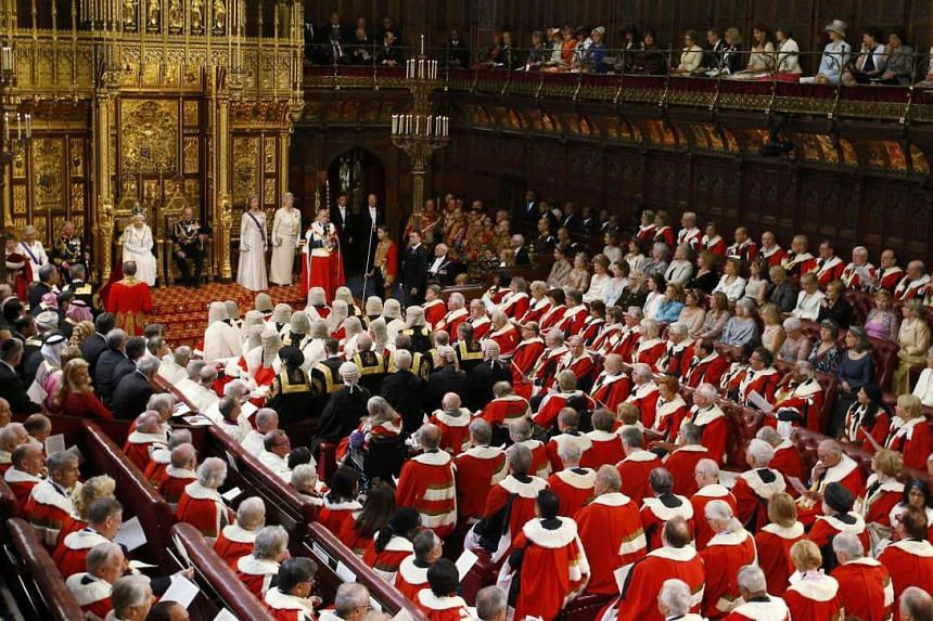 Britain's Queen Elizabeth II awaits lawmakers at the House of Lords before the State Opening of Parliament on May 27, 2015.