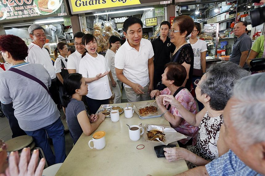 Minister for Social and Family Development Tan Chuan-Jin visits MacPherson Division with MP Tin Pei Ling.