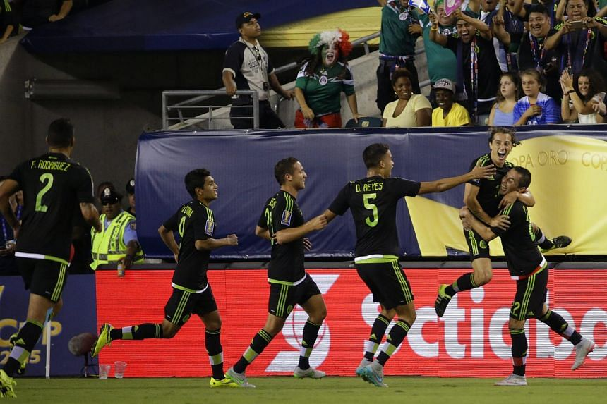 Mexican players celebrating a goal in the Gold Cup final against Jamaica.