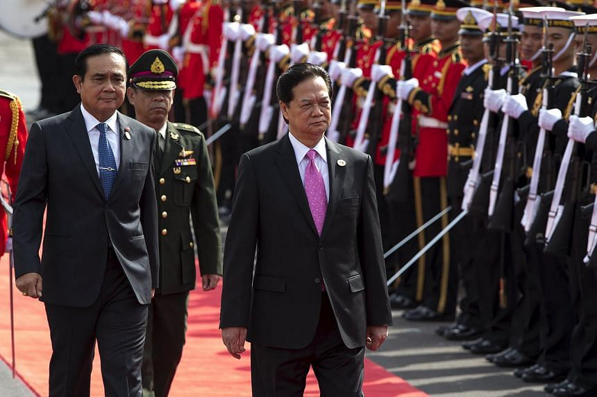 Vietnam's Prime Minister Nguyen Tan Dung and Thailand's Prime Minister Prayuth Chan-ocha (left) during a welcoming ceremony at Government House in Bangkok, Thailand.