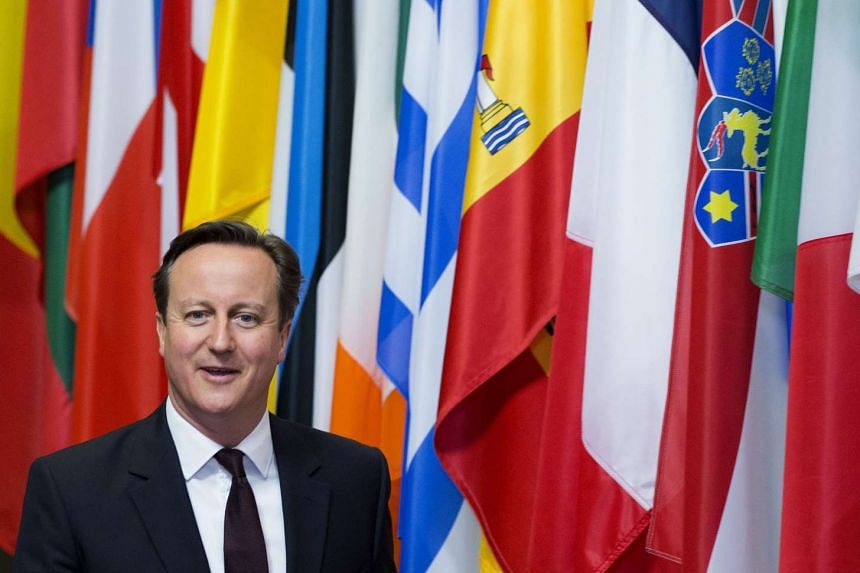 British Prime Minister David Cameron leaves the European Council headquarters after the first day of a European Union leaders summit in Brussels, Belgium, June 26, 2015.
