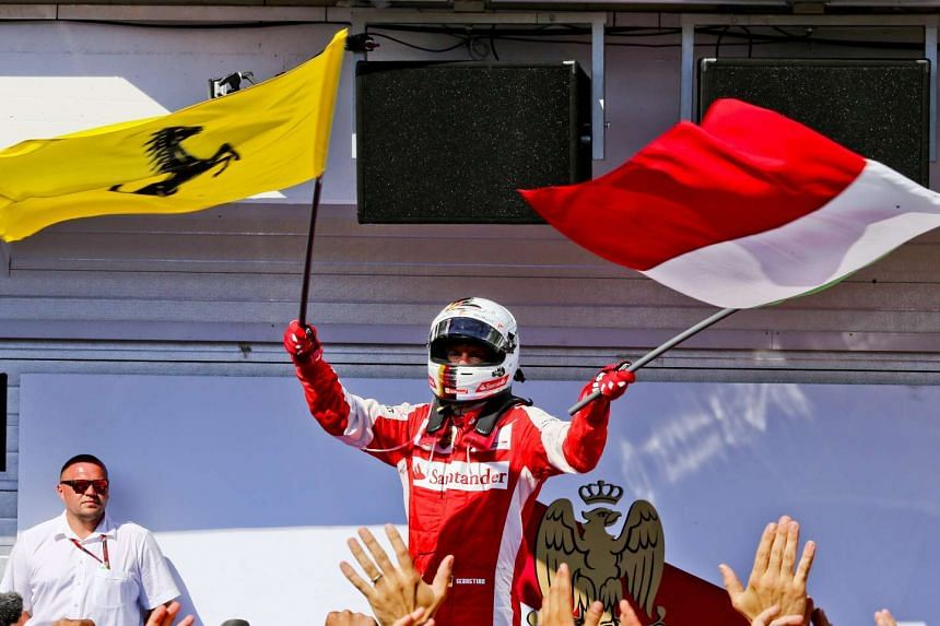 Ferrari driver Sebastian Vettel of Germany celebrating after winning the Formula One Grand Prix of Hungary at the Hungaroring race track in Mogyorod near Budapest, Hungary, on July 26, 2015.