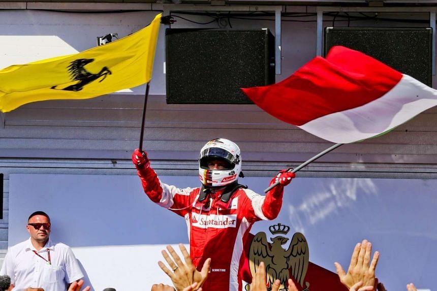 Ferrari driver Sebastian Vettel of Germany celebrating after winning the Formula One Grand Prix of Hungary at the Hungaroring race track in Mogyorod near Budapest, Hungary, on July 26, 2015.