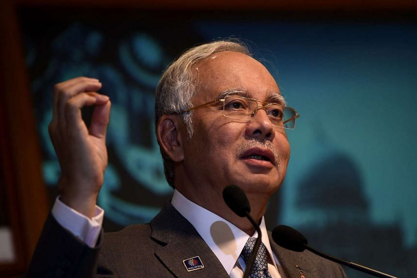 Malaysian Prime Minister Najib Razak told his deputy and other officials on Monday to stop commenting on a graft scandal at 1MDB.