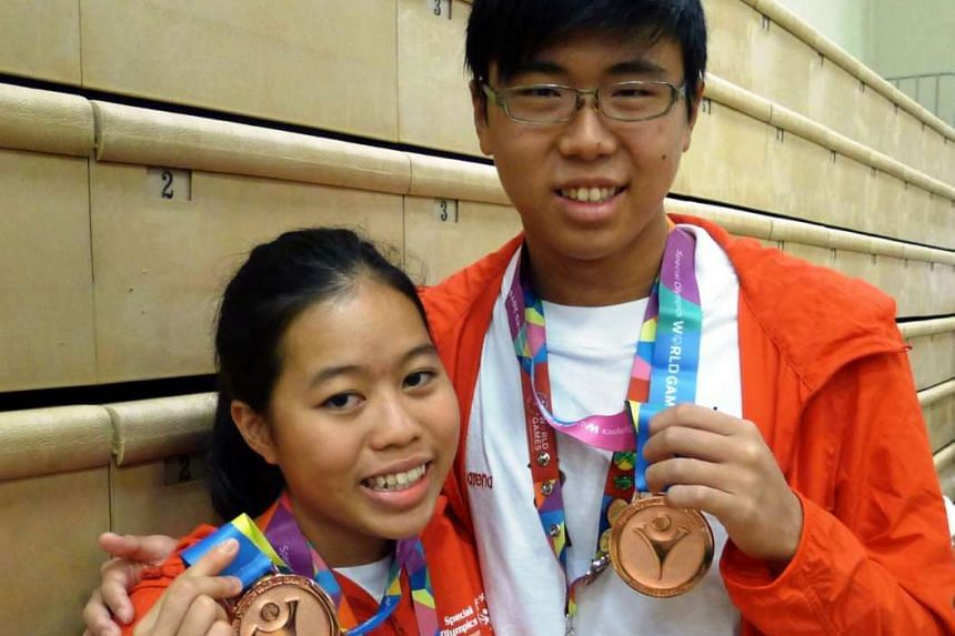 Danielle Moi (left) and Han Liang Chou each contributed a bronze medal to Singapore's medal haul, in the women's 200m individual medley and the men's 100m backstroke respectively.