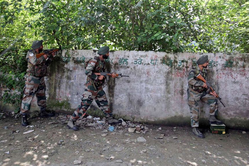 Indian Army soldiers taking up positions as an exchange of fire continued with militants holed up in the police station at Dinanagar in Gurdaspur, India, on July 27, 2015.