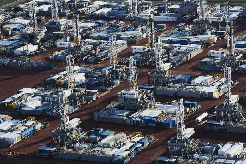 Stacked rigs are seen along with other idled oil drilling equipment at a depot in Dickinson, North Dakota.