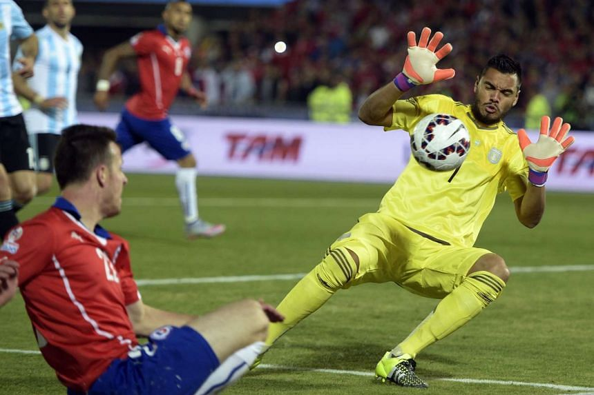 Argentina's goalkeeper Sergio Romero (right) saves a a shot during the 2015 Copa America football championship final.