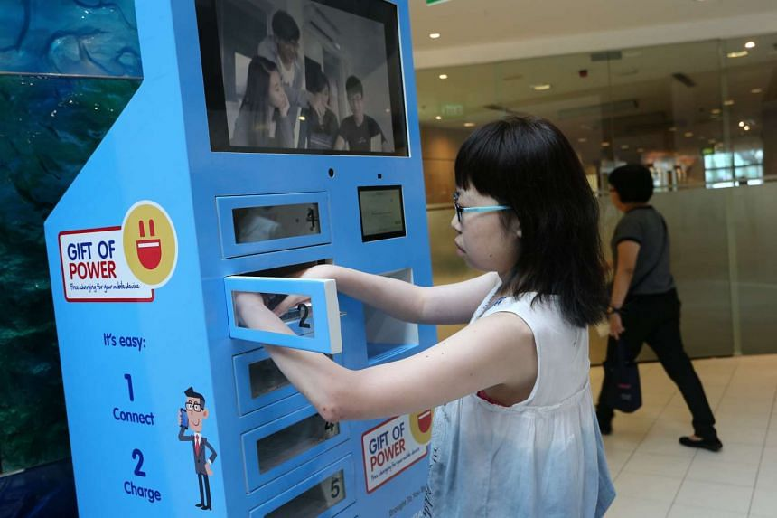 A user trying out the charging station at the Singapore National Eye Centre at SGH.