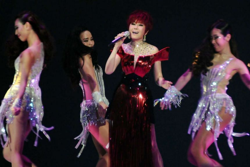 Hokkien pop goddess Jody Chiang performing in Taipei in the first of her 25 farewell concerts.