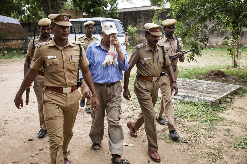 Subhash Kapoor (above) being escorted to court by police in India early this month; and the Varadharaja Perumal temple, where idols were discovered missing in 2008.