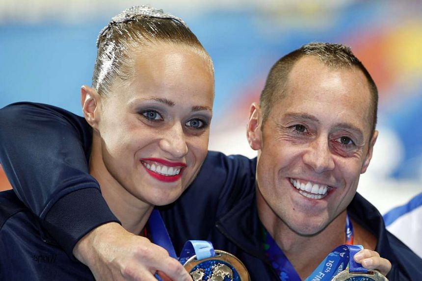 Christina Jones (left) and Bill May at the FINA Swimming World Championships in Kazan, Russia on July 26, 2015.