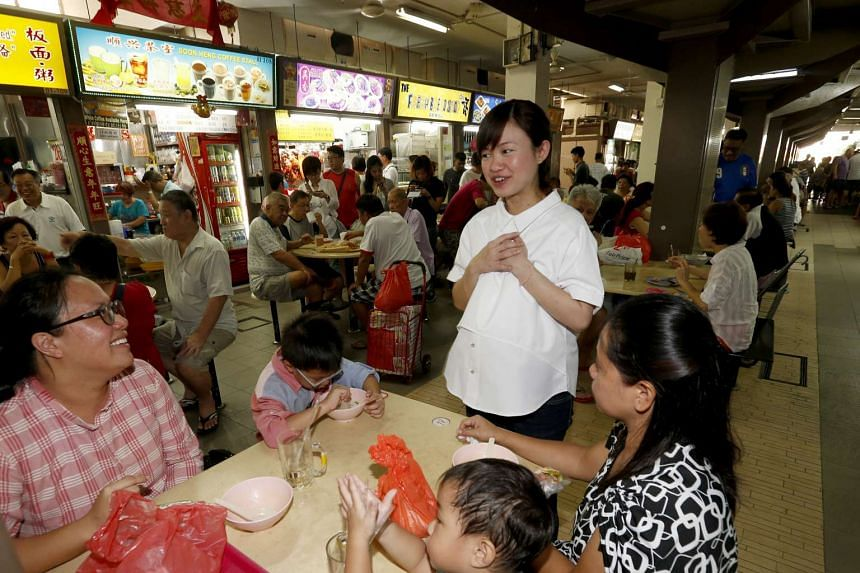 Ms Tin Pei Ling, who is heavily pregnant, was stopped along the way by residents wanting to chat and to take photos with her.