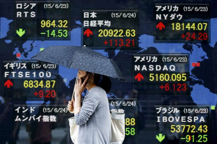 An electronic board displaying various countries' stock price index outside a Tokyo brokerage.