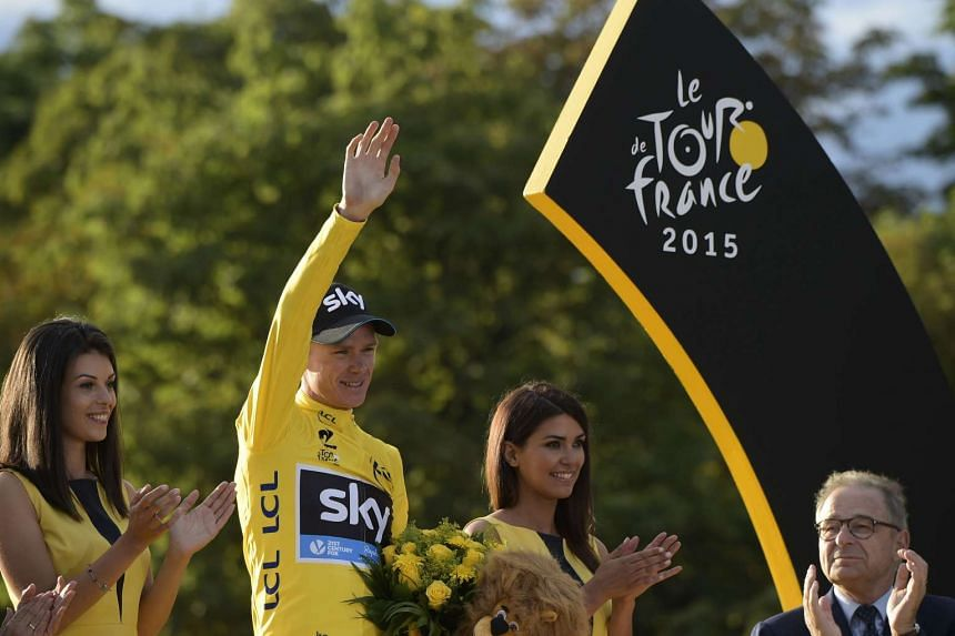 Tour de France 2015 winner Froome celebrates his victory on the podium on the Champs-Elysees avenue in Paris.