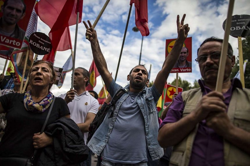 Members of the Kurdish community holding a rally outside the Turkish embassy to protest against the Turkish air force attacks on the PKK military campaigns in Syria and northern Iraq, in Paris, France, on July 27, 2015.