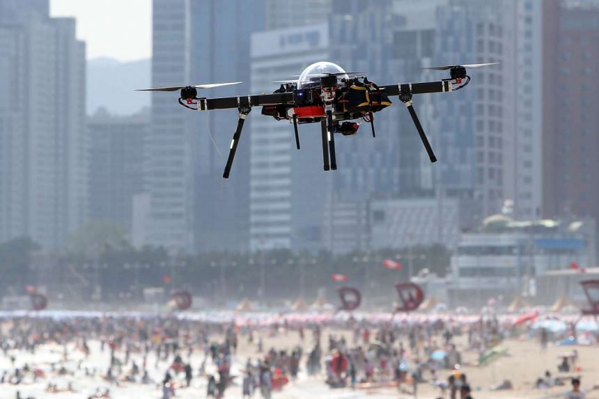 A public safety drone hovers above Haeundae beach in Busan on July 28, 2015. The Busan city government are using the drone on the popular Haeundae beach as a public safety measure during the school holiday period.
