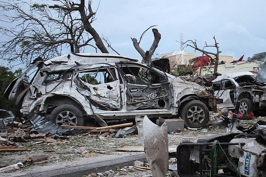 Several vehicles were destroyed around Jazeera Palace hotel in Somalian capital Mogadishu after Sunday's suicide bombing.