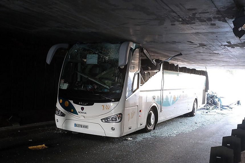 The wreckage of the bus after it crashed into a bridge in northern France on Sunday. The roof of the bus was ripped off.