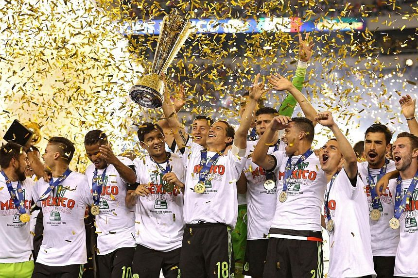 Andres Guardado of Mexico (holding trophy) and team-mates celebrate after defeating Jamaica 3-1 in the Concacaf Gold Cup final in Philadelphia on Sunday. It was Mexico's seventh title while host nation United States finished fourth.