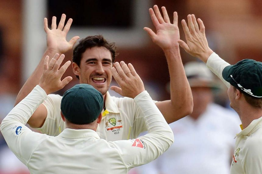 Australia's Mitchell Starc celebrates after dismissing England's Adam Lyth at Investec Ashes Test Series.