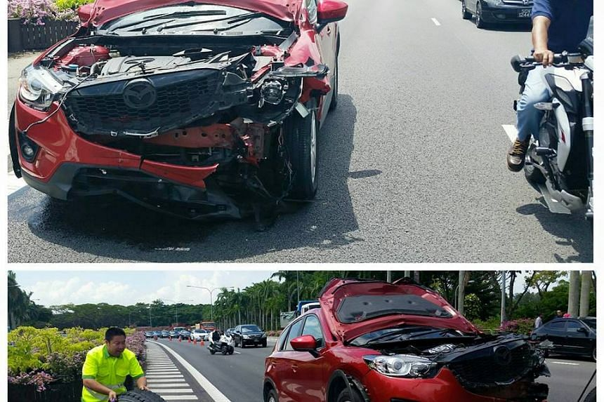 A tyre flew off a truck and landed on a couple's car while they were driving along ECP.