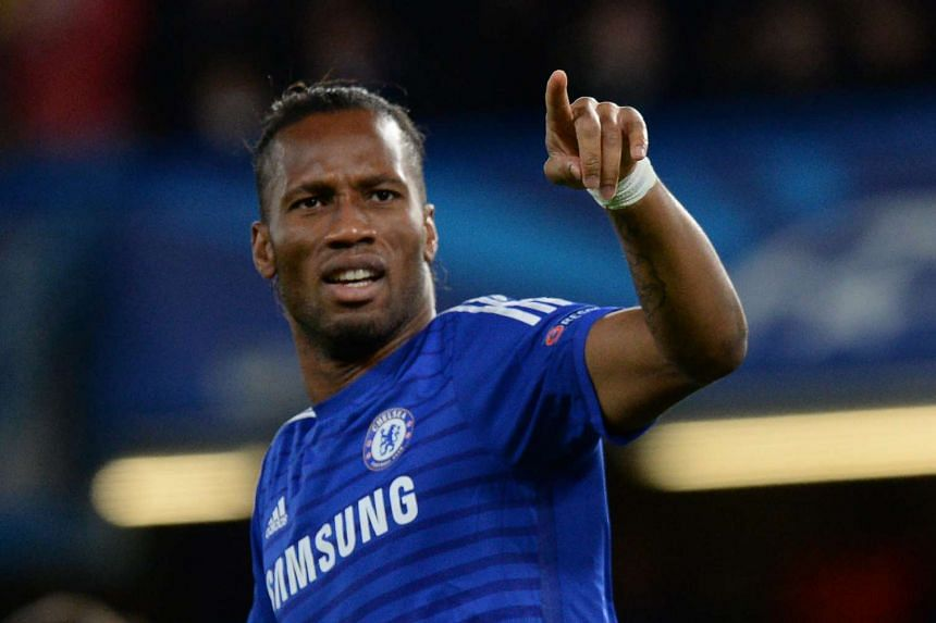 Didier Drogba celebrating during a Uefa Champions League match.