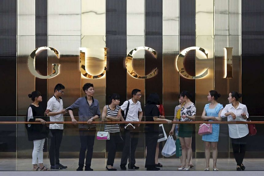 Tourists outside the Gucci shop at Marina Bay Sands in Singapore.