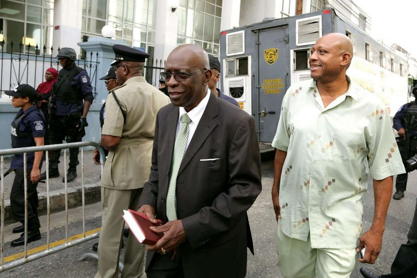 Former Fifa vice-president Jack Warner (centre) leaving the Port-of-Spain Magistrates court in Trinidad, after an extradition hearing on July 27, 2015.