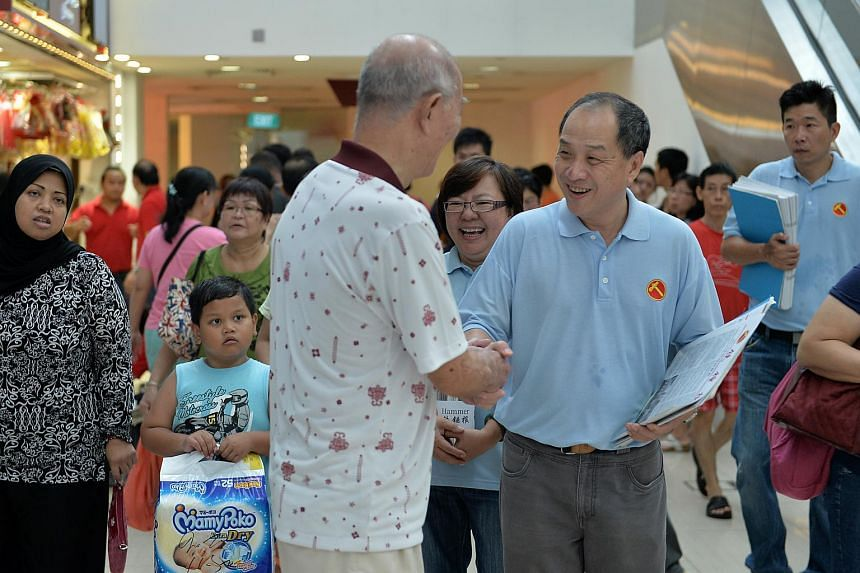 Workers' Party chief Low Thia Khiang speaking to a shopper at Rivervale Plaza during a walkabout on July 26.