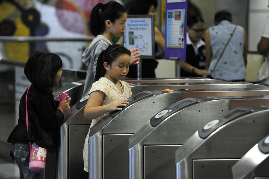 Young commuters at Dhoby Ghaut MRT station in 2012.