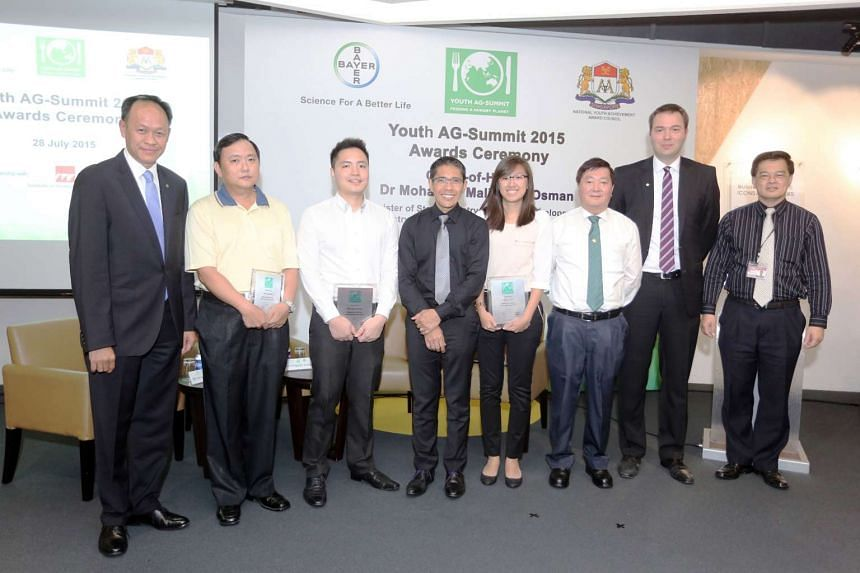 Mr Koh Shao Cong (third from left) and Ms Oh Su Chin (fourth from right) received their award from Minister of State Maliki Osman (centre) at the Youth AG-Summit Awards Ceremony on Tuesday. Also receiving a special award was the late Toh Jun Pen's fa