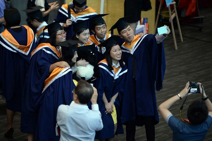 NTU graduates taking a selfie at their convocation ceremony on July 27, 2015.