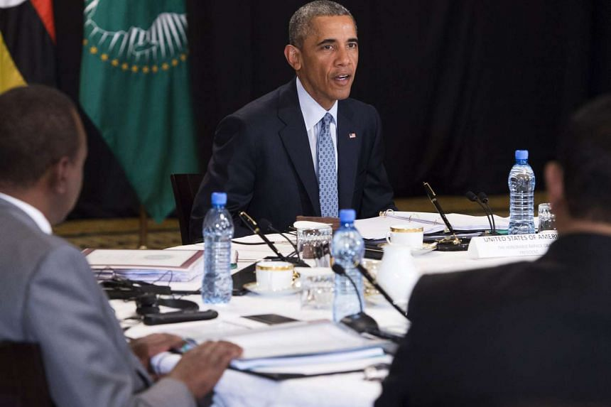 US President Barack Obama (centre) during a meeting with representatives from Uganda, Ethiopia, Kenya, the African Union and Sudan.