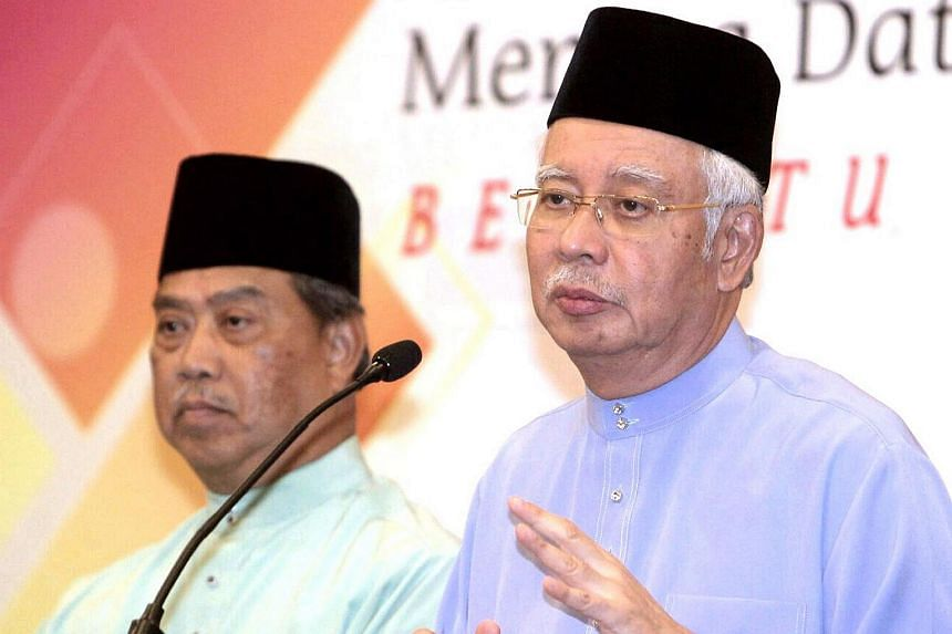 Malaysian Prime Minister Najib Razak (right), with Deputy Prime Minister Muhyiddin Yassin at the Umno Supreme council meeting press conference.