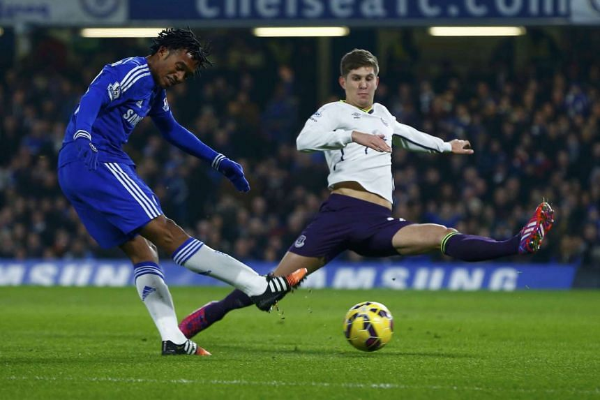 Everton defender John Stones (right), here defending against Chelsea winger Juan Cuadrado, is highly coveted by Blues boss Jose Mourinho. The Blues will reportedly make a renewed bid to sign the England international today.