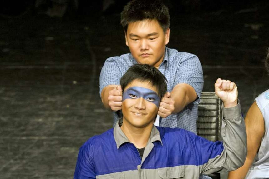 Students from Nanyang Junior College performing The Car by Verena Tay.