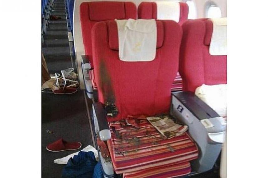 The inside of the cabin of a Shenzhen Airlines flight after a man tried to set fire to the cabin as it was landing in southern China on 26 July 2015.