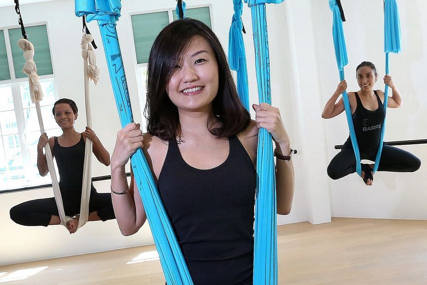 Ms Beh Hwee Sze (centre), 31, founder of fitness studio Upside Motion, with her staff, Ms Elly Selamat (left), 26, and Ms Mirna Liguori, 35. Upside Motion offers pilates, Xtend barre and the aerial programme. It conducts 100 classes a week in total a