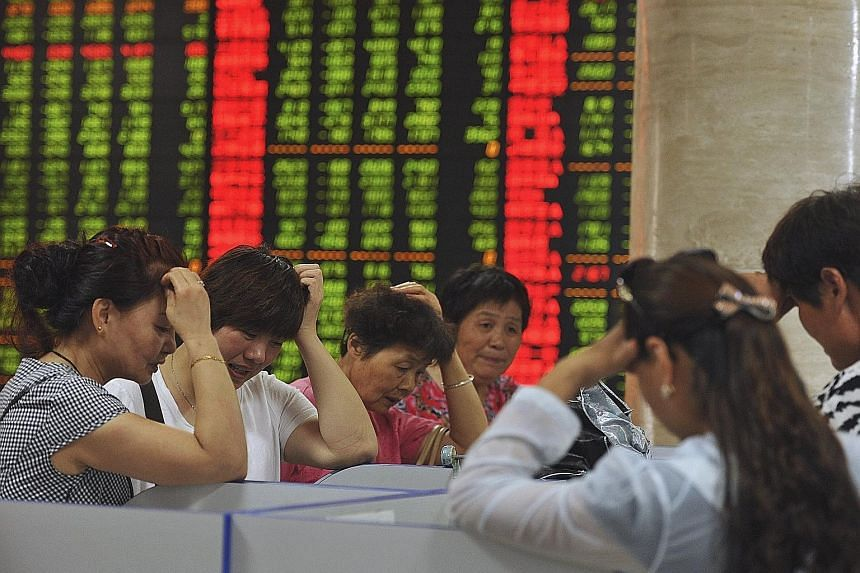 Investors at a brokerage house in Fuyang, in China's Anhui province, yesterday. Shanghai stocks have shed 11 per cent since last Friday and are down 29 per cent from their highest point this year.