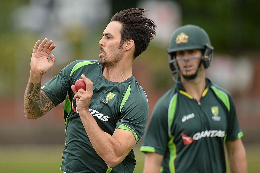 Australia's Mitchell Johnson bowling during a training session, watched by batsman Mitchell Marsh. The paceman took six wickets in the 405-run drubbing of the hosts in the second Test and his team are pleased with the way he is easing into the series