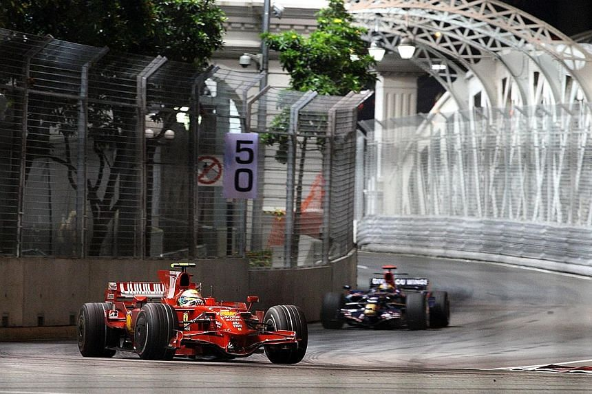 A Ferrari car making a turn after the Anderson Bridge at the Singapore Grand Prix. The Turn 13 hairpin turn after the bridge will be widened by one metre for this year's GP in September.