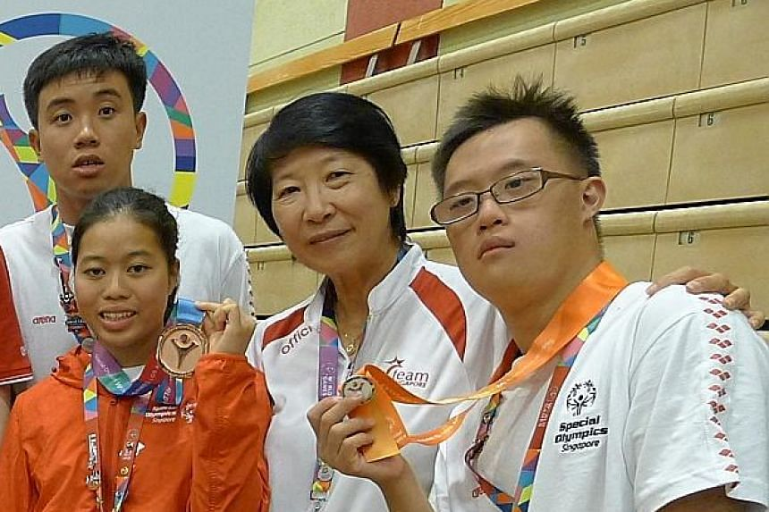 Singapore's gold winners Danielle Moi (left) and Bryan Seow (right).