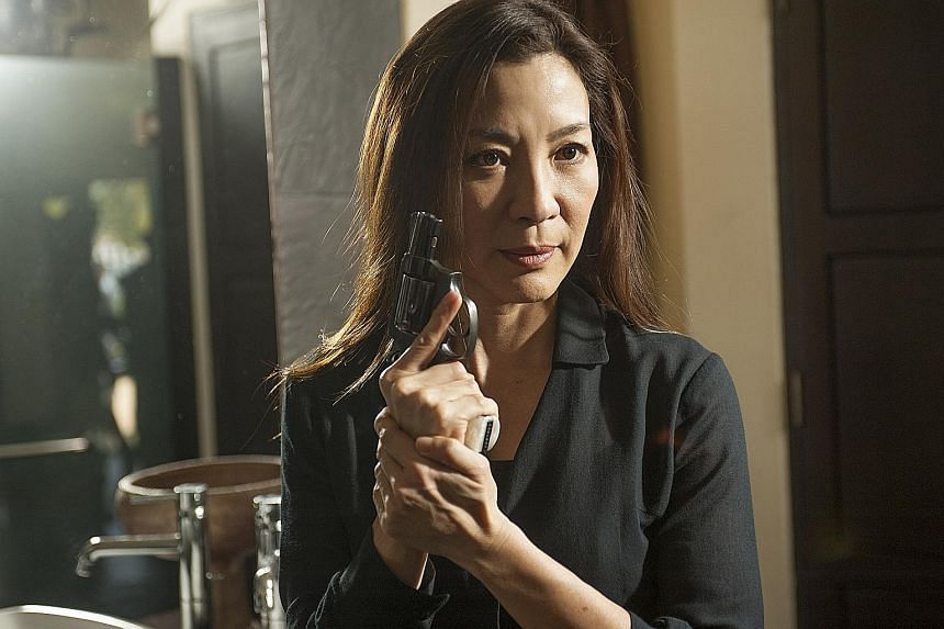 Gongfu star Michelle Yeoh (above) adds to the action in Strike Back and Liev Shreiber is Ray Donovan.