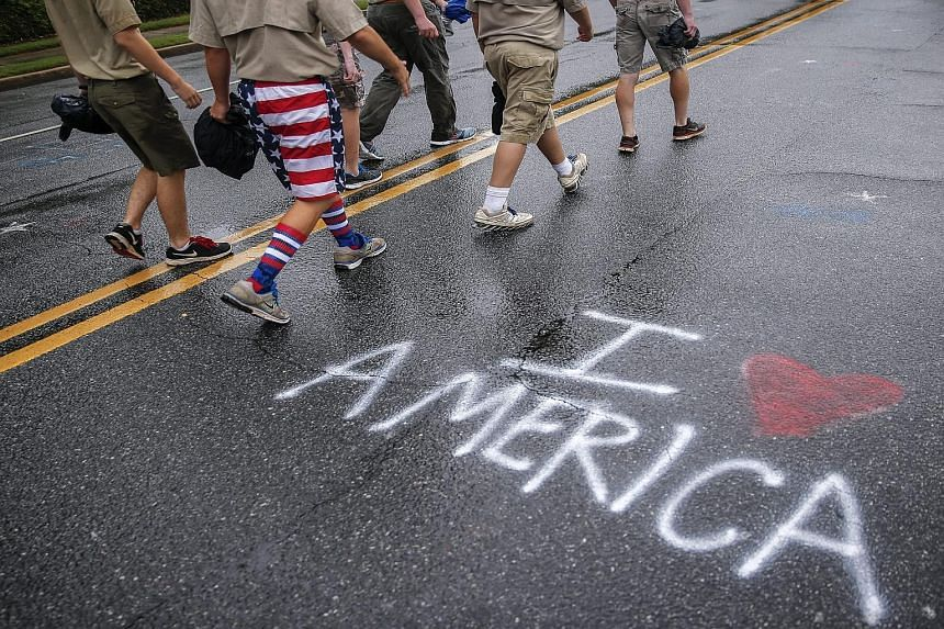 Boy Scouts at an Independence Day parade in Georgia, in the US, on July 4. The new policy takes effect immediately.